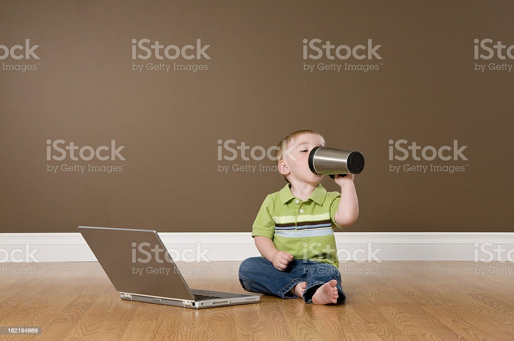 Toddller With Laptop Drinking From Coffee Mug royalty-free stock photo