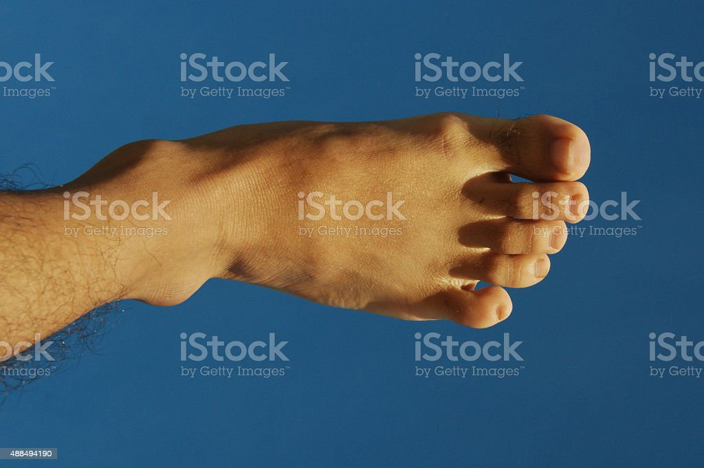 toe foot kick the blue sky stock photo