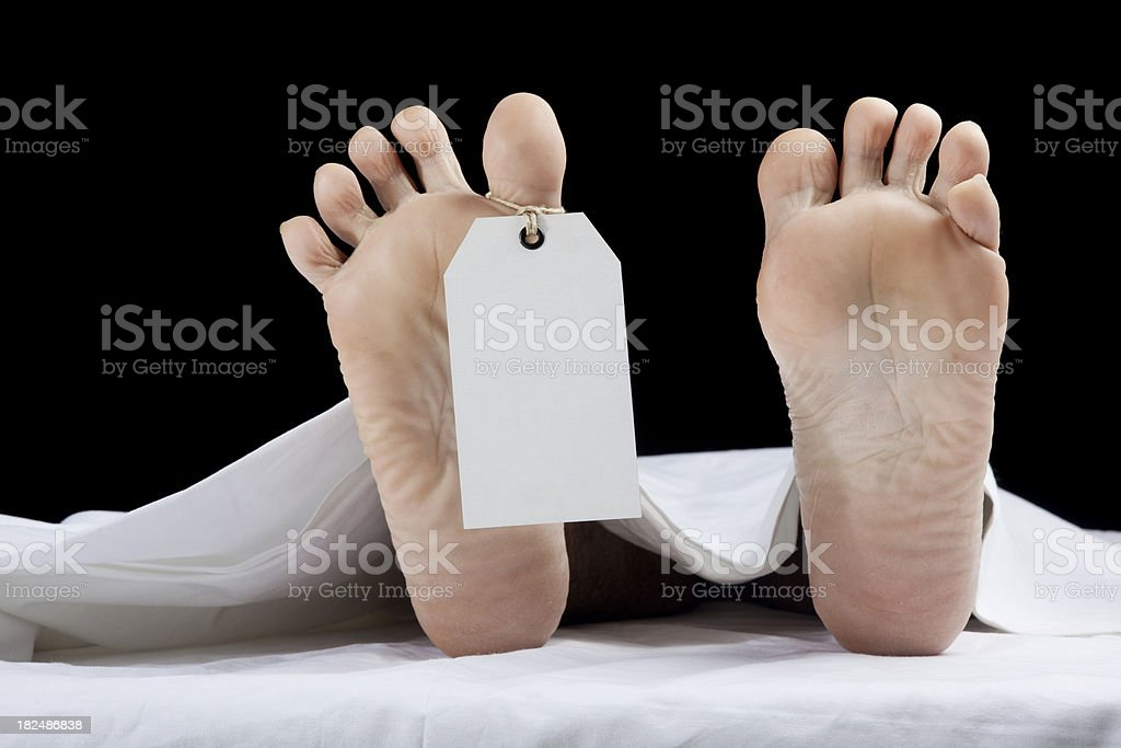 Toe tag on human foot stock photo