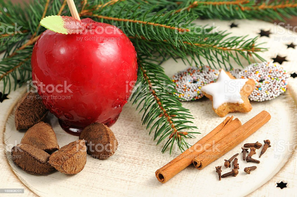toffee apple Christmas decoration plate cookies brazil nutes fir tree stock photo