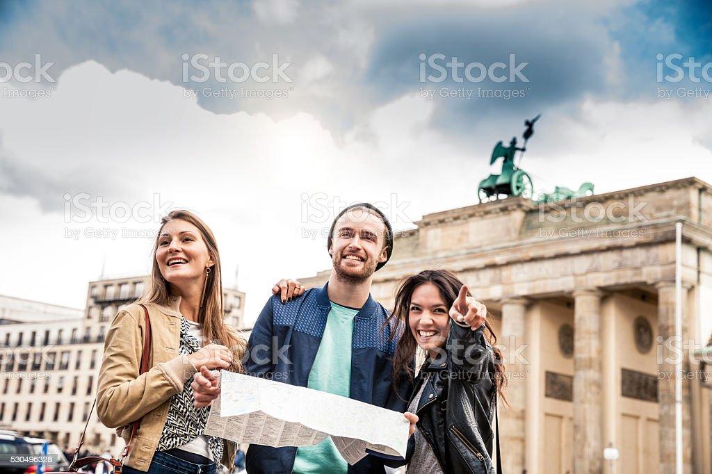 Together on travel in Berlin - Brandenburg Gate stock photo
