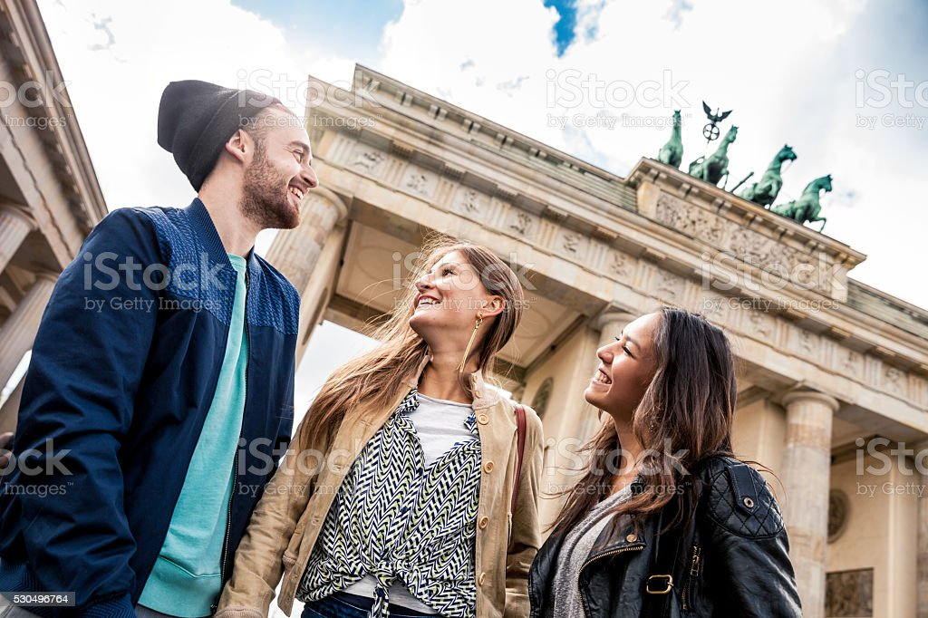 Together on travel in Berlin - Brandenburg Gate stock photo