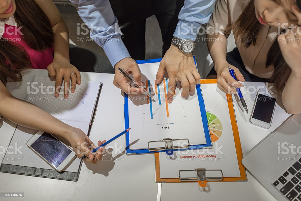 Together they thinking about solution to increase sales income stock photo