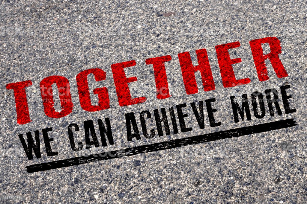 Together we can achieve more , words on asphalt road stock photo