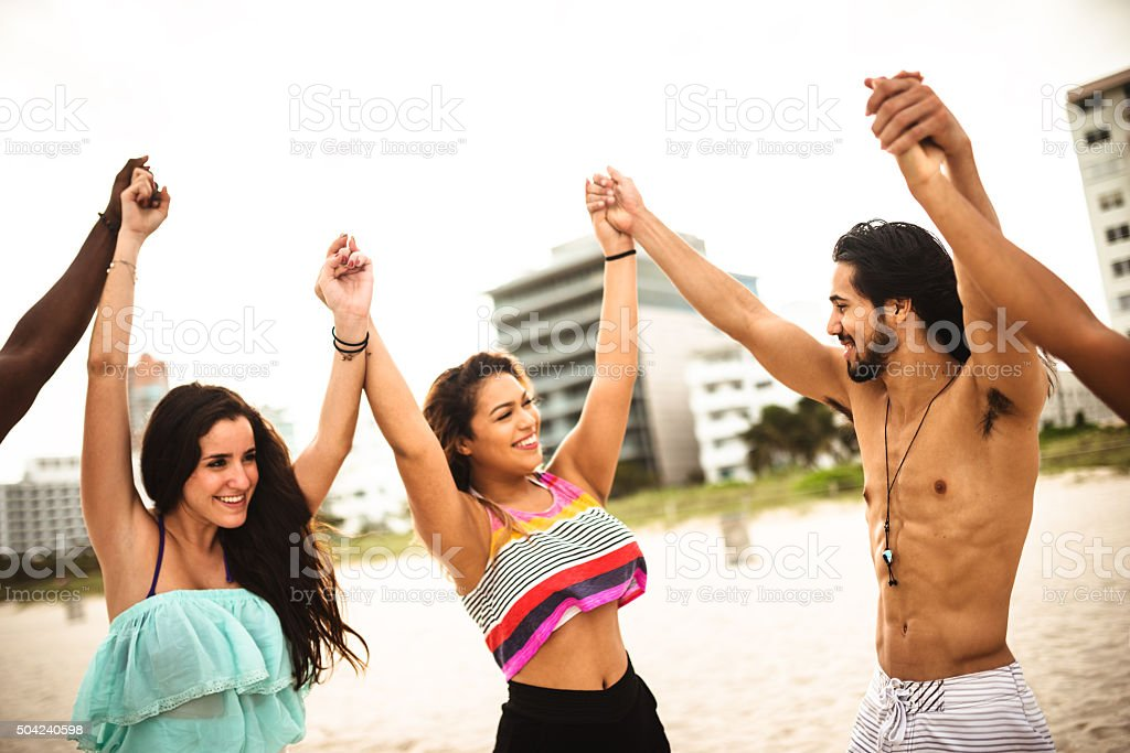Together with arm raised stock photo
