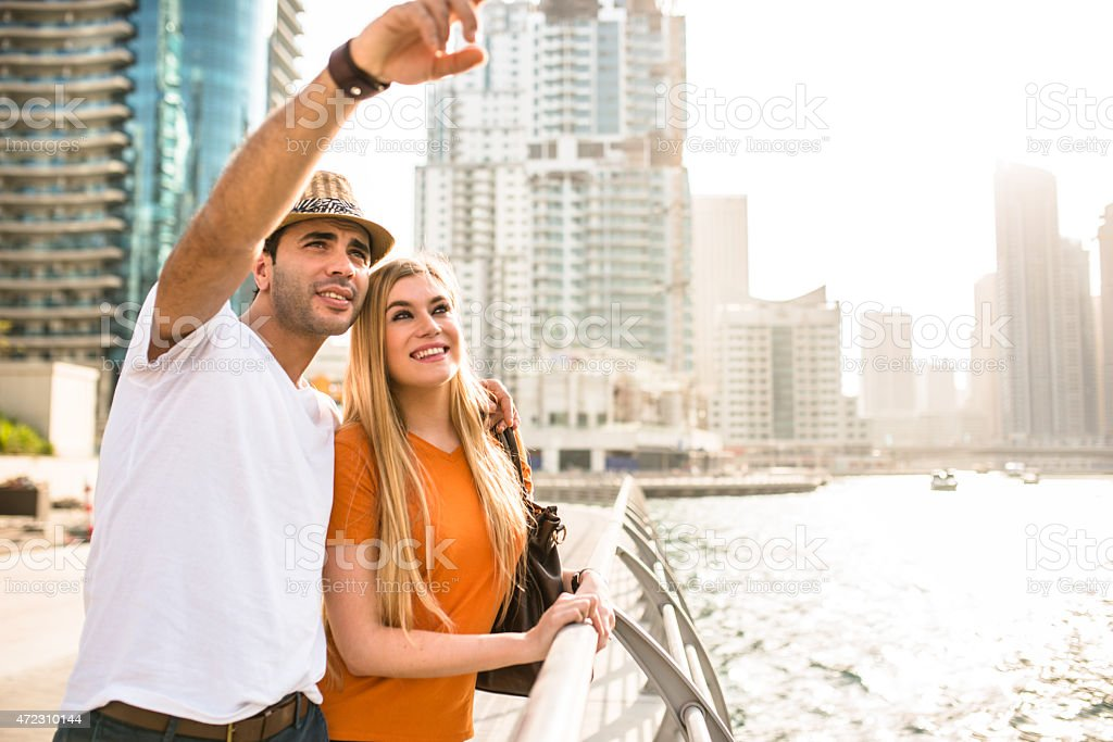 togetherness couple in vacations on Dubai Marina - UAE stock photo