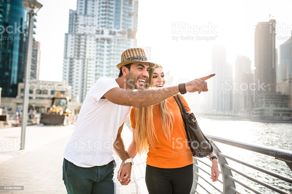togetherness couple in vacations on Dubai Marina - UAE stock photo