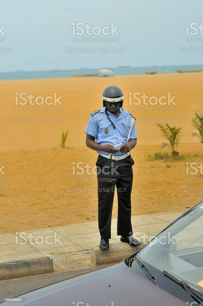Togo Cop Writing Parking Ticket stock photo