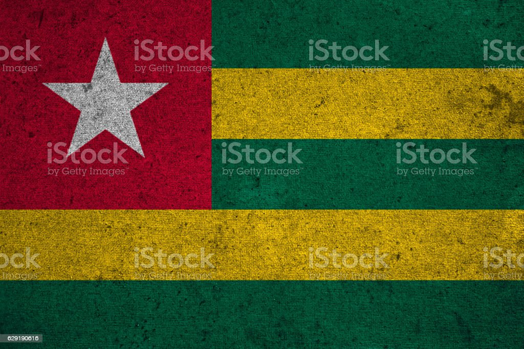 Togo flag on an old grunge background stock photo