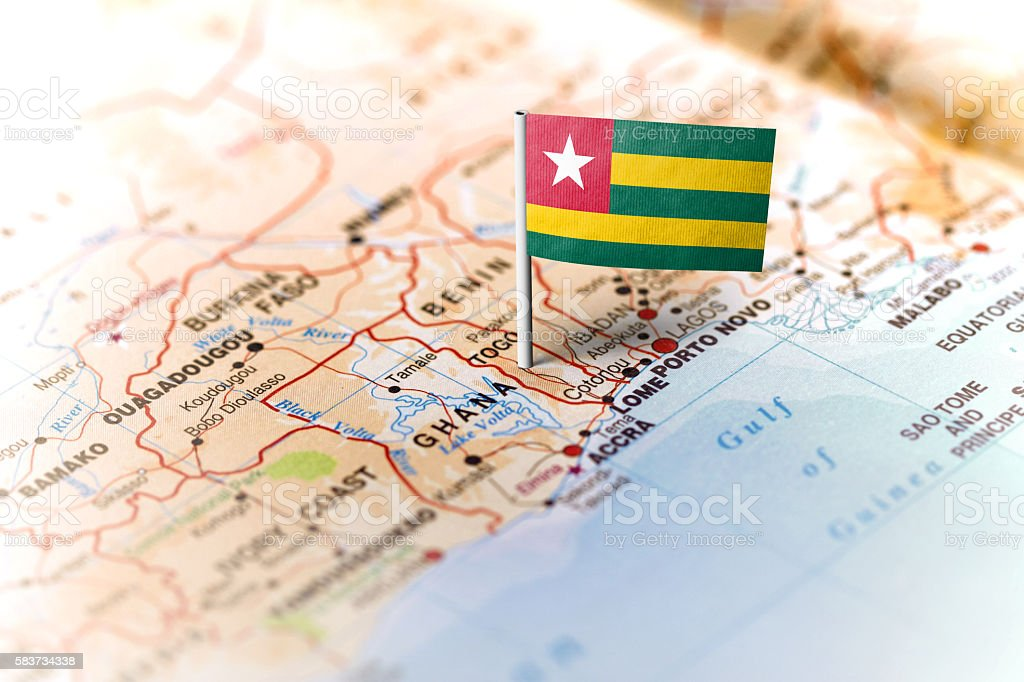 Togo pinned on the map with flag stock photo