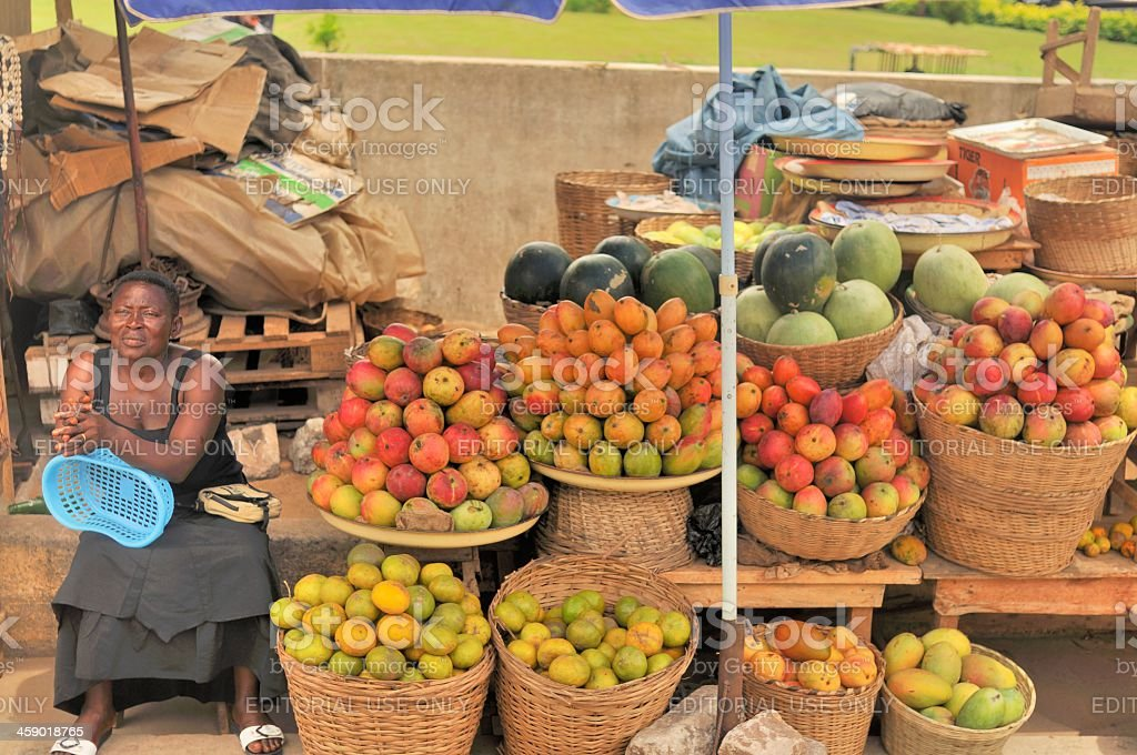 Togo Woman Sidewalk Vendor stock photo