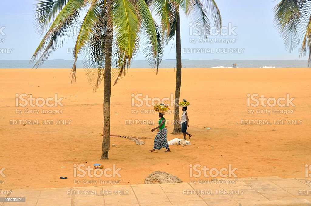 Togo Women Carrying Fruit On The Beach stock photo