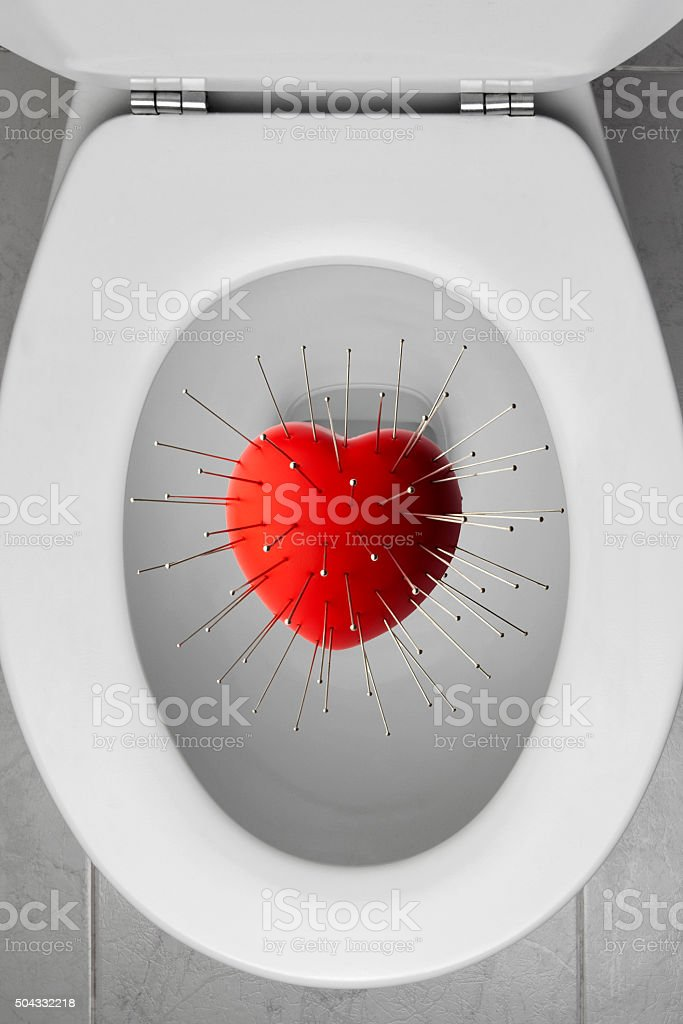 Toilet Bowl with a Vodoo in a Heart stock photo