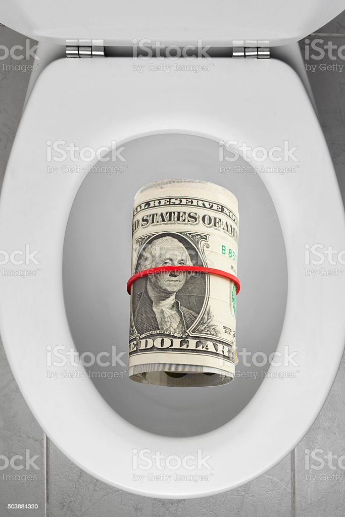 Toilet Bowl with American Currency stock photo