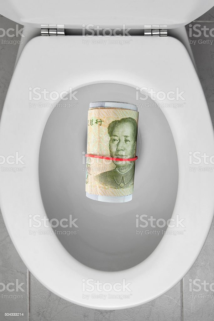 Toilet Bowl with Chinese Currency stock photo