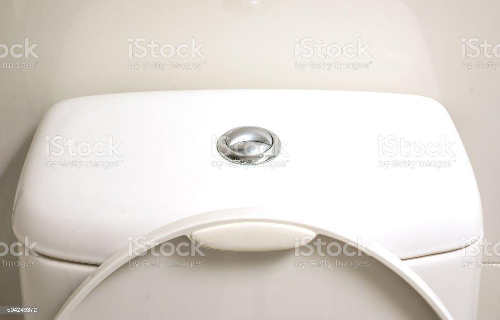 Toilet button stock photo