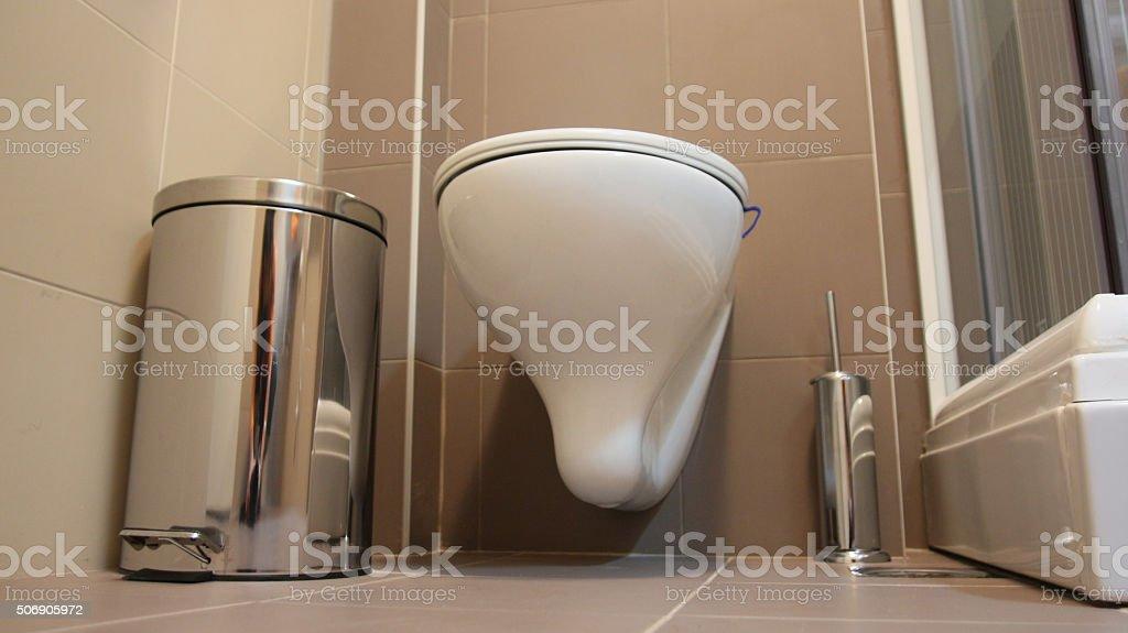 Toilet device inside the bathroom stock photo