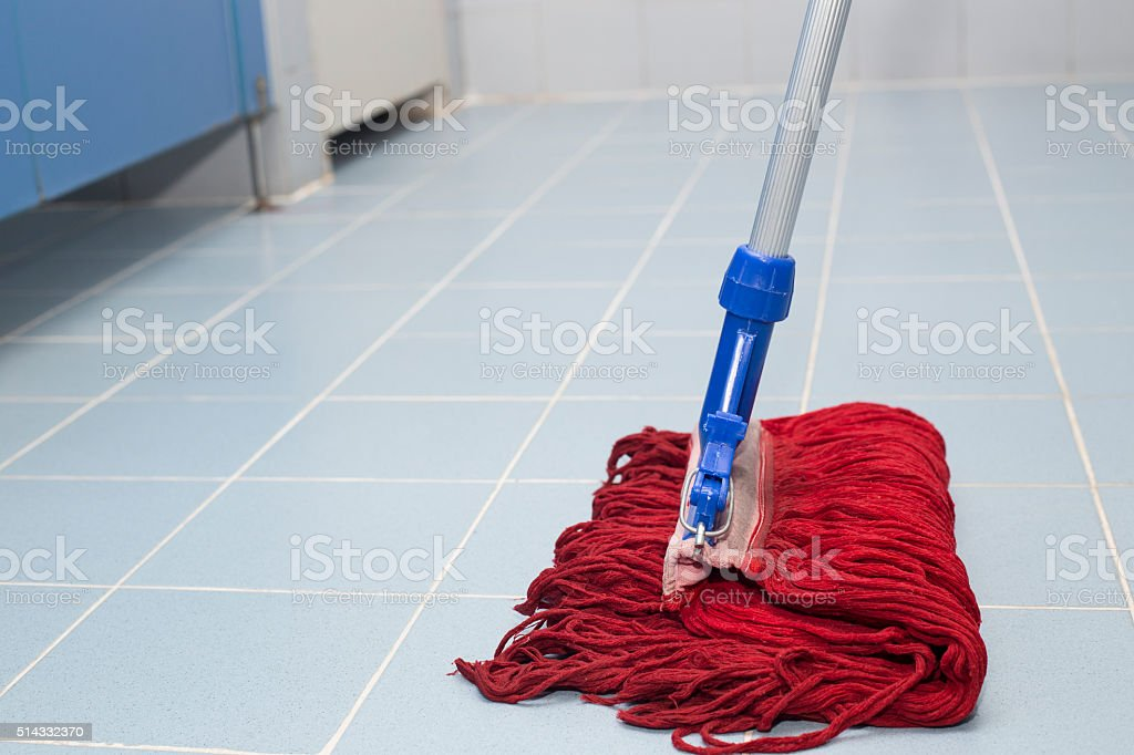toilet floor cleaning with red mob stock photo