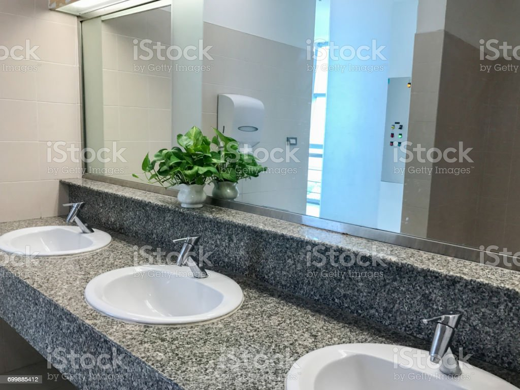 toilet interior with white sink and faucet stock photo