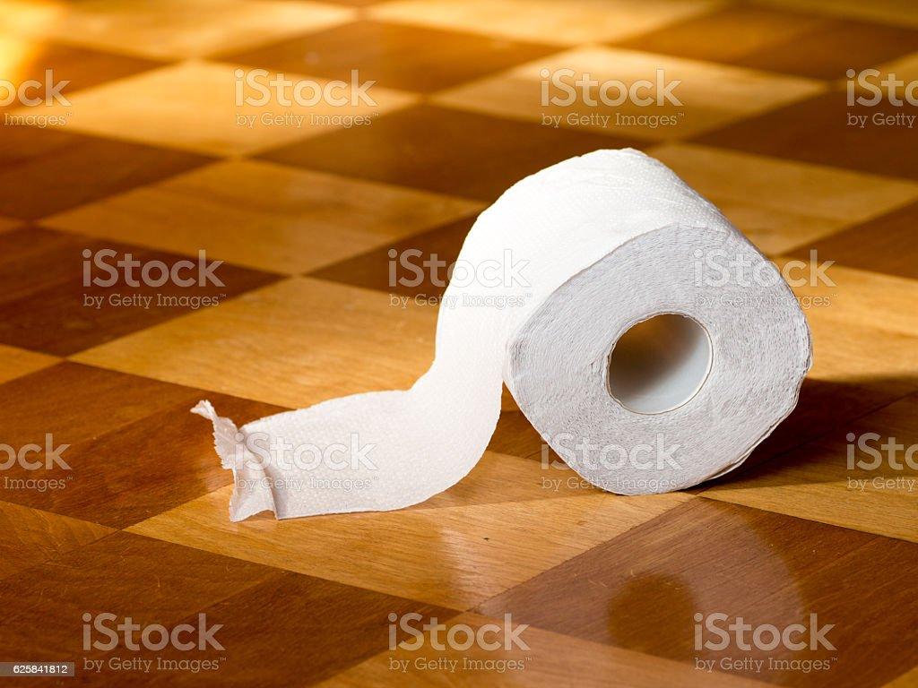 Toilet paper on the wooden floor stock photo