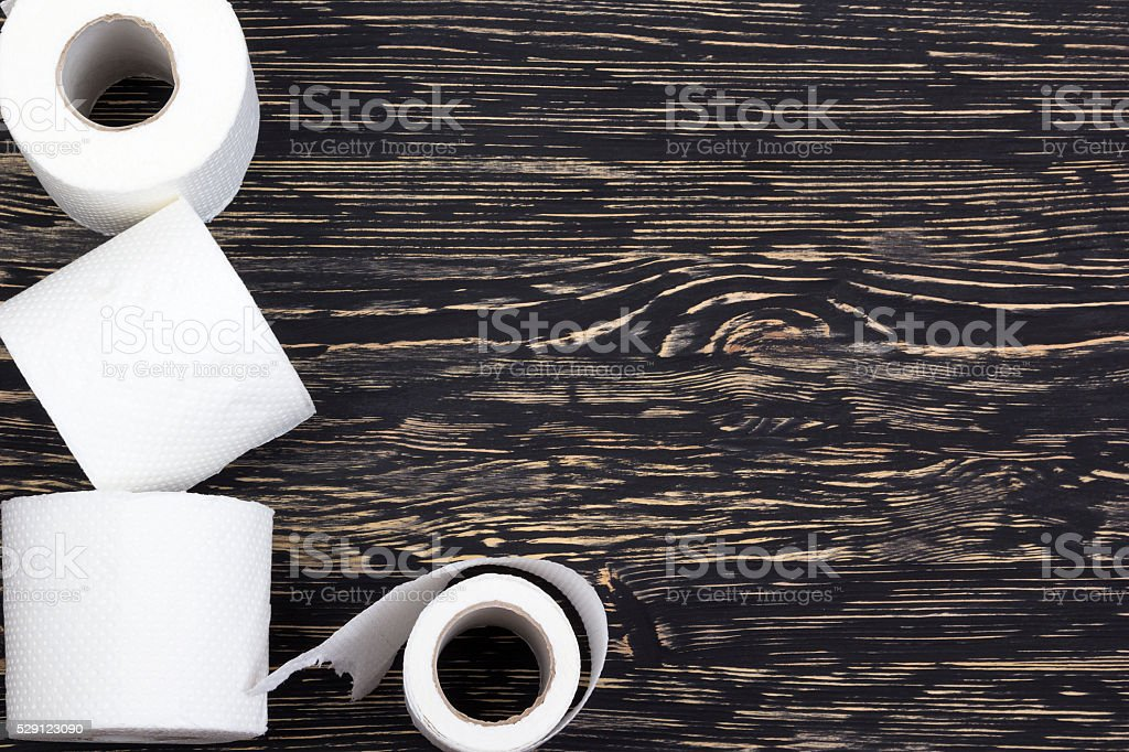 Toilet paper on wooden board stock photo