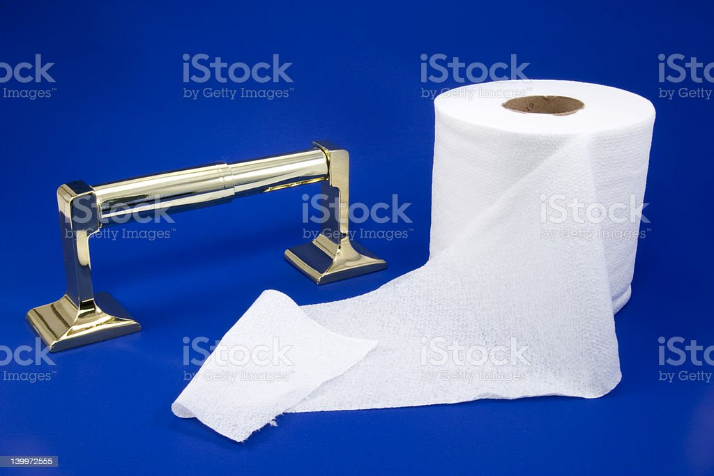 Toilet paper roll and dispenser royalty-free stock photo