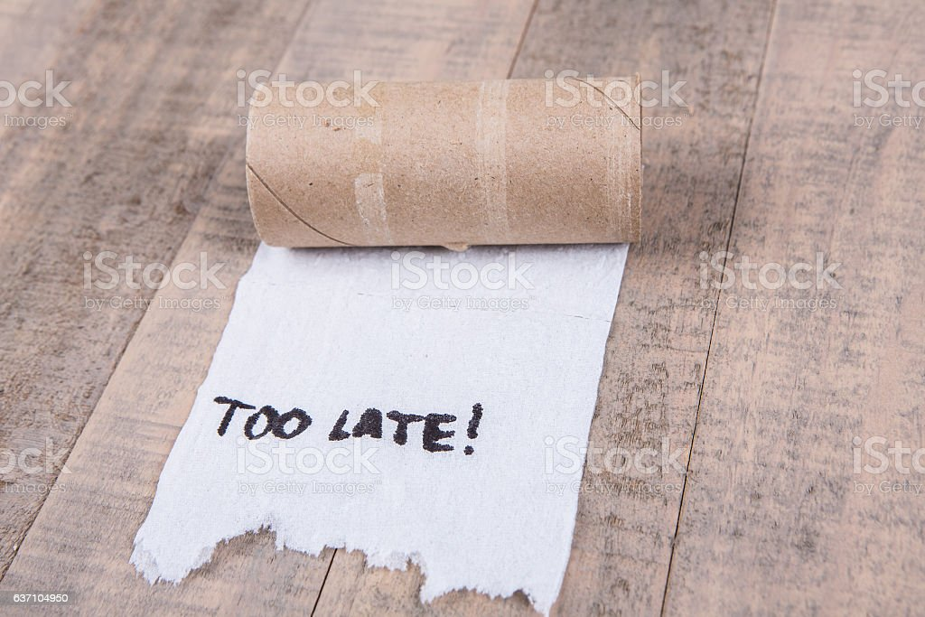 Toilet paper rolls out of paper with message stock photo