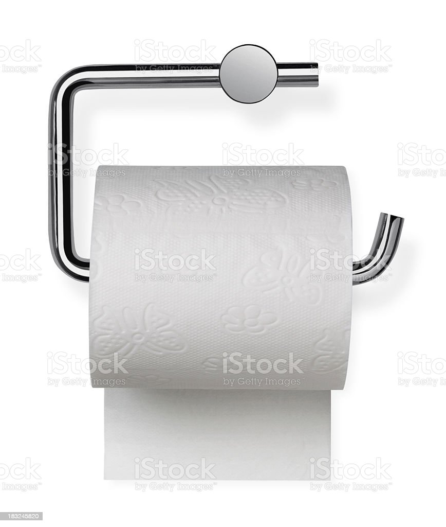 Toilet paper sitting on its holder stock photo