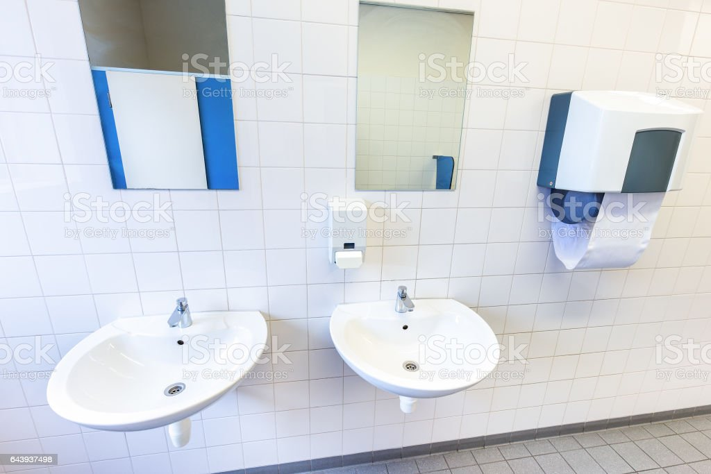 Toilet room for men with sinks and mirrors stock photo