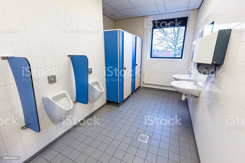 Toilet room for men with urinals sinks and towel dispenser stock photo
