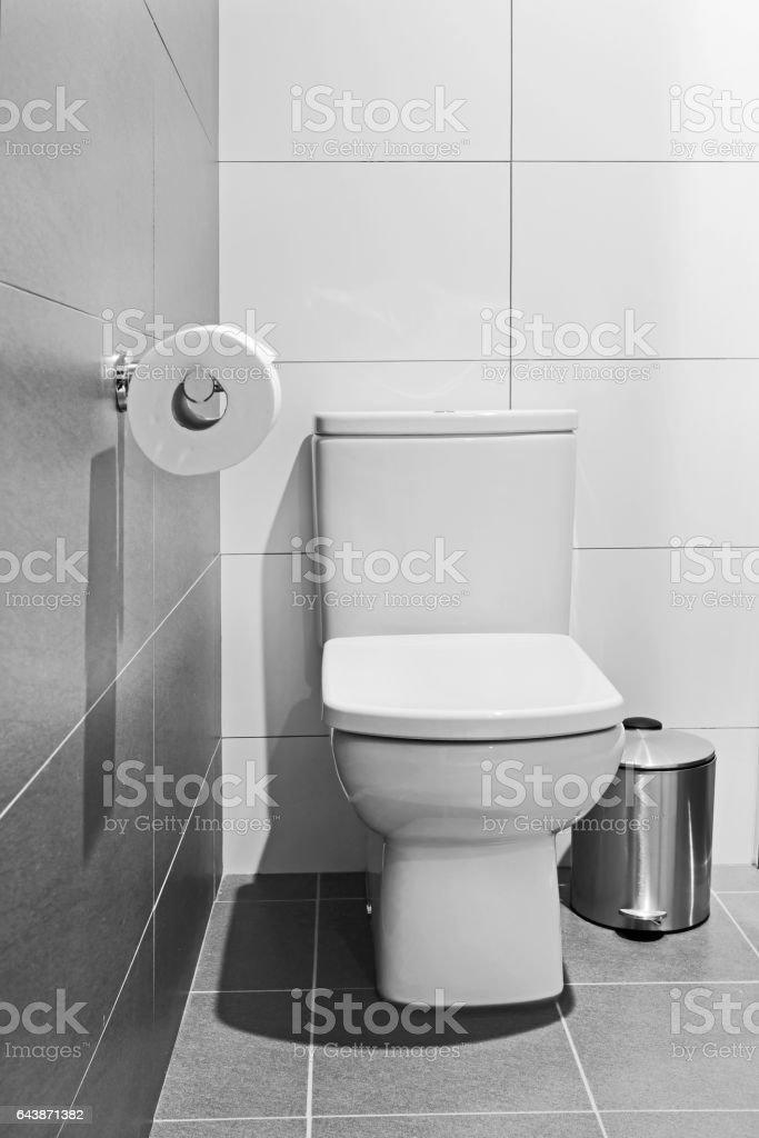Toilet seat paper bin stock photo