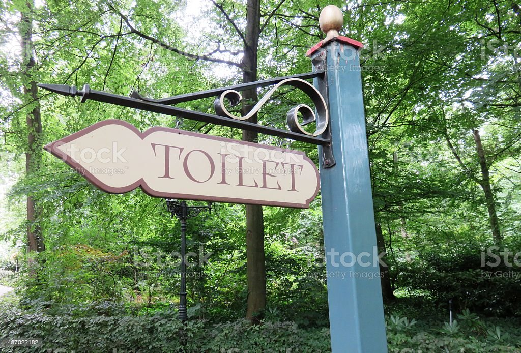 Toilet sign in the forest stock photo