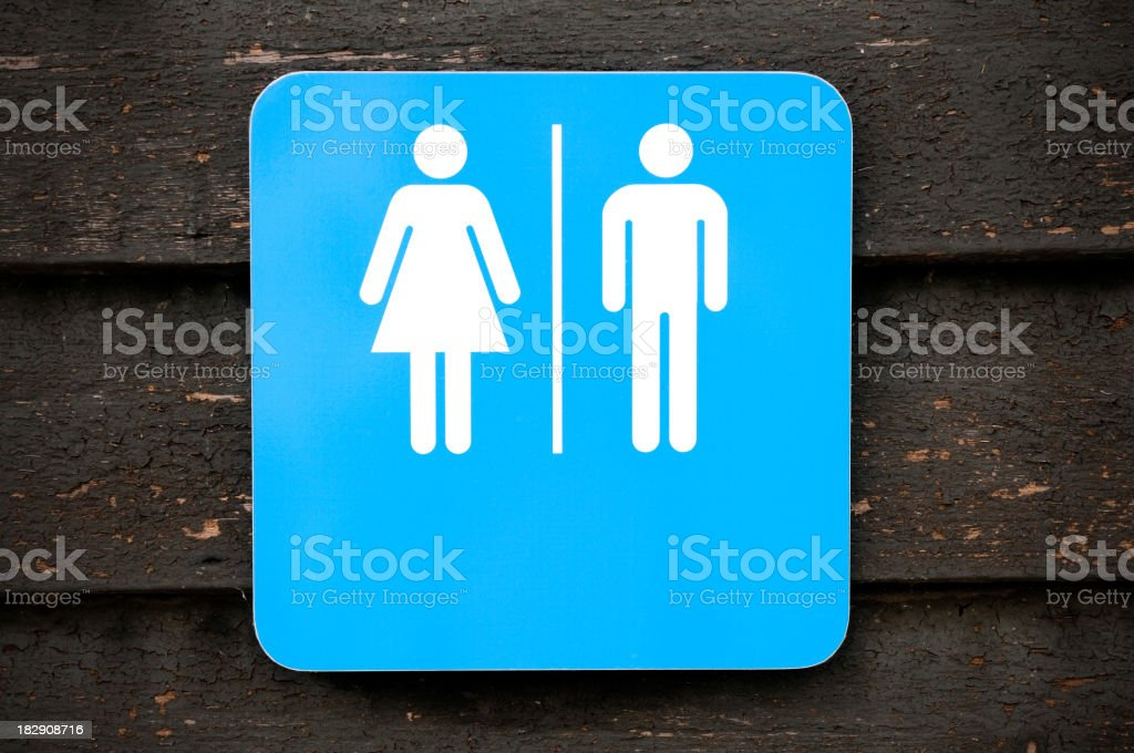 Toilet sign, modern look on old wooden background royalty-free stock photo