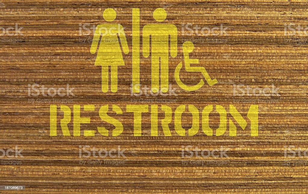 Toilet sign on wooden background royalty-free stock photo
