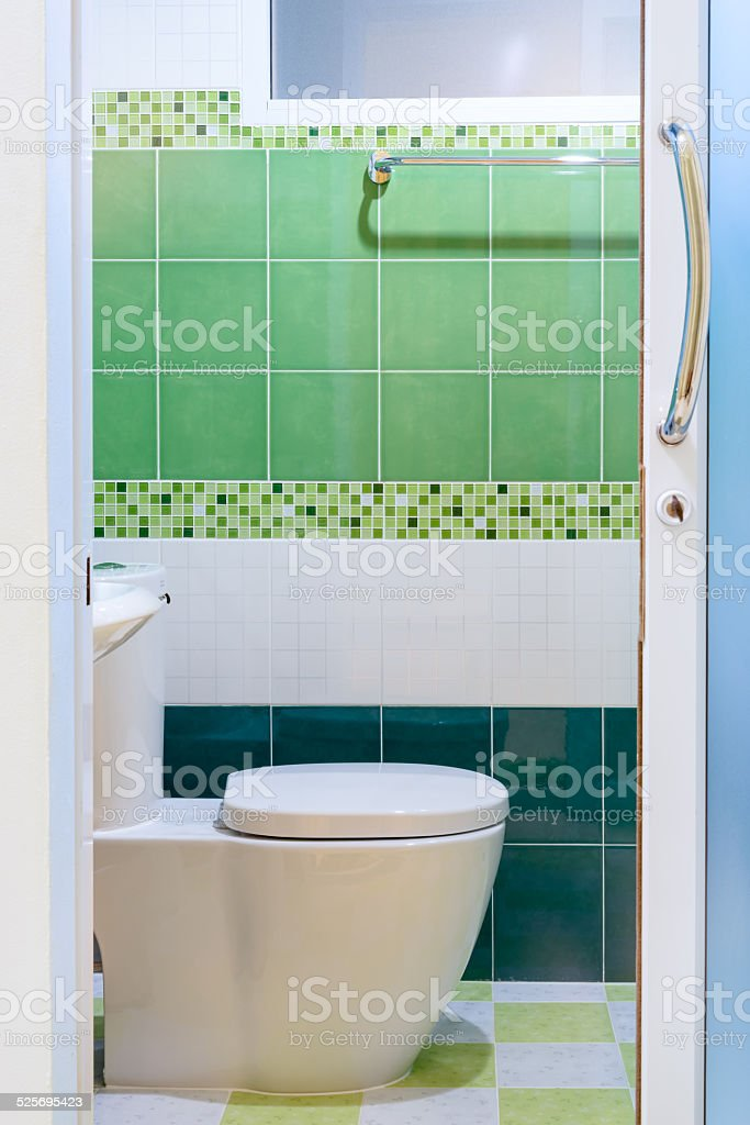 Toilet with green tile view stock photo