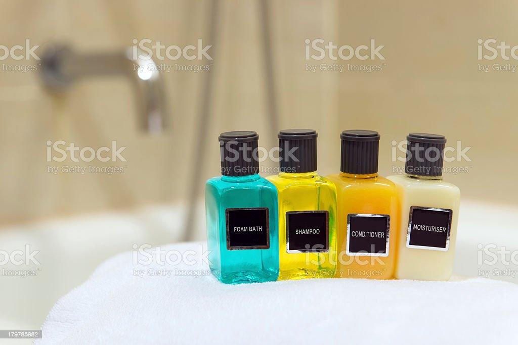 Toiletries in a row on a white towel stock photo