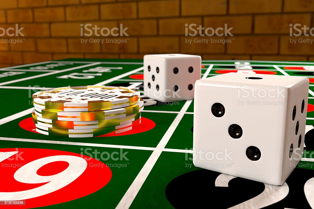 tokens and dices on the roulette table stock photo