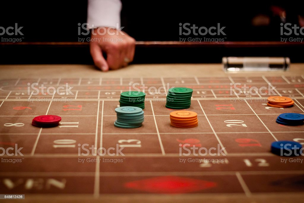 Tokens on roulette table stock photo