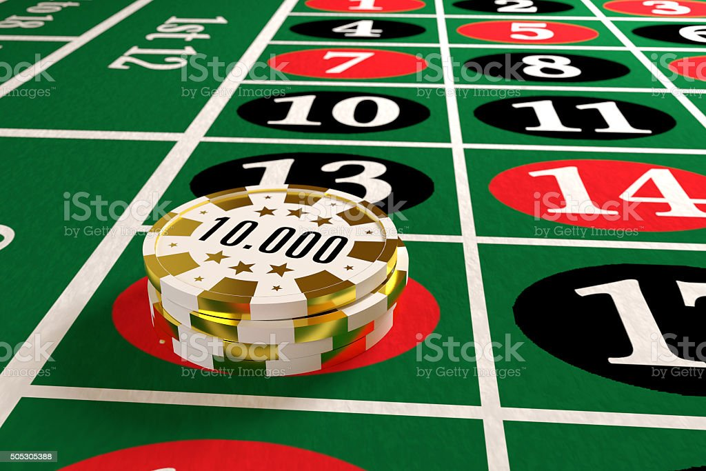 tokens stack on the roulette table stock photo