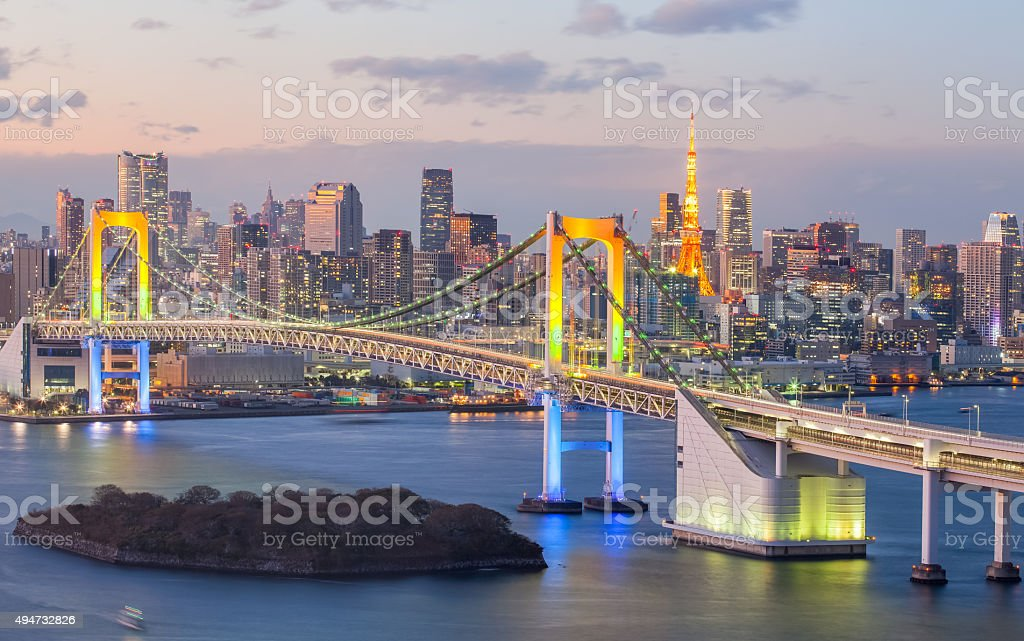 Tokyo bay and Tokyo rainbow bridge in evening stock photo