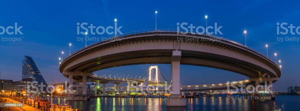 Tokyo Bay Rainbow Bridge highway harbour loops illuminated dusk Japan royalty-free stock photo
