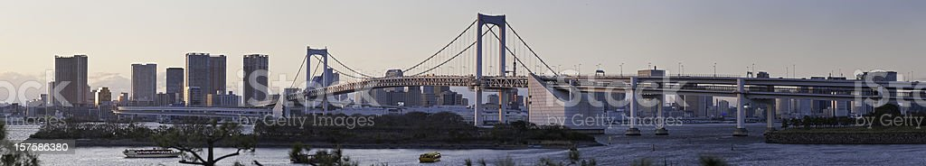 Tokyo Bay Rainbow Bridge waterfront skyline sunset towers panorama Japan royalty-free stock photo