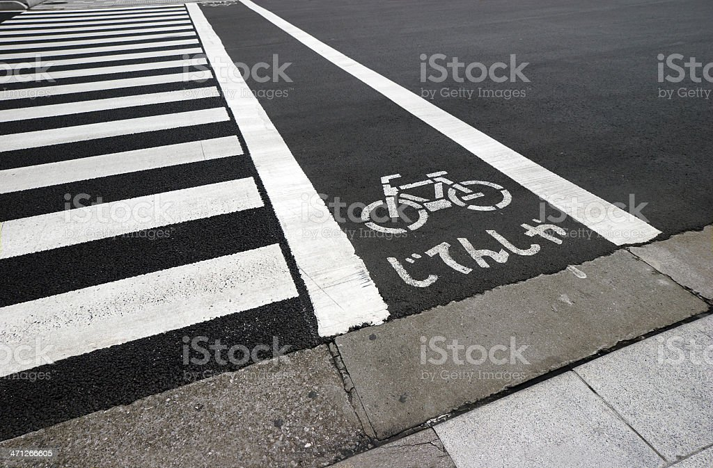 Tokyo: Bicycle lane and pedestrian crossing ??? royalty-free stock photo