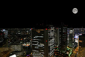 Tokyo cityscape at night with the full moon