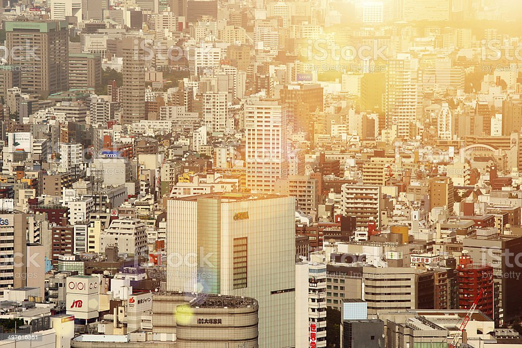 Tokyo cityscape at sunset: skyscrapers, towers, buildings, skyline royalty-free stock photo