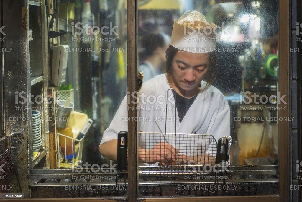 Tokyo cook working in restaurant night kitchen Shinjuku Japan royalty-free stock photo