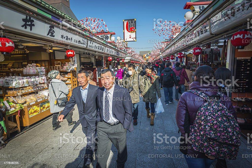 Tokyo crowds enjoying sunshine Nakamise-dori market Senso-ji temple Asakusa Japan stock photo