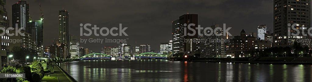 Tokyo neon night panorama waterfront skyscrapers downtown Sumida bridges Japan stock photo