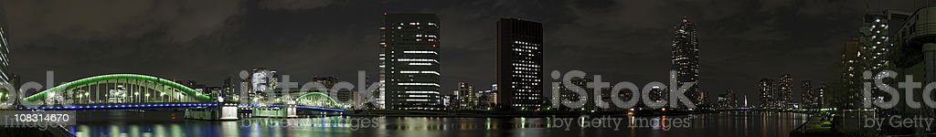 Tokyo neon night skyline panorama Sumida River Chuo-Ku Kachidoki-bashi Japan stock photo