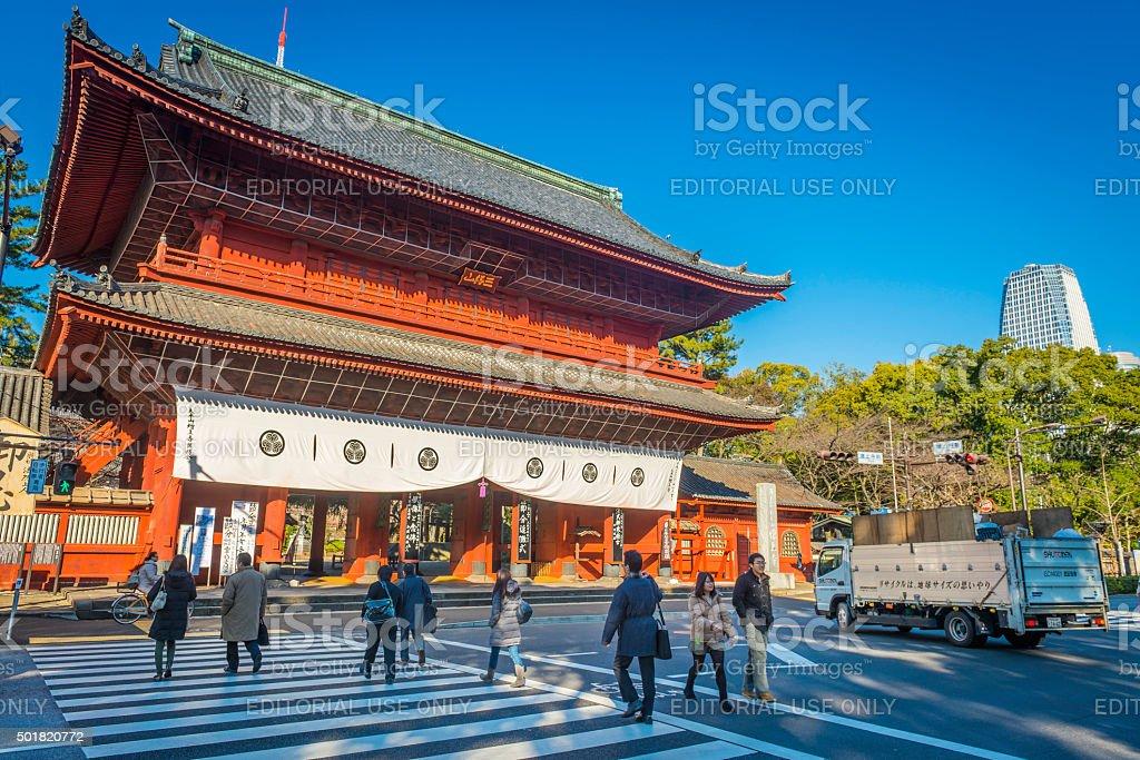 Tokyo people crossing street below Shiba-Koen  Temple red gate Japan stock photo